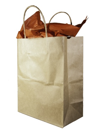 A tan gift bag with handles and red tissue papter.