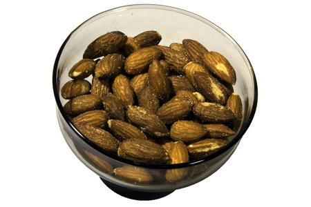 A gray glass bowl of almond nuts on a white background.