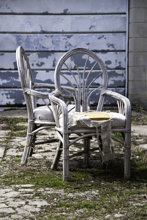 junked: A pair of worn out chairs that have been discarded.