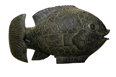 gills: A small statue of a fish in a gray color with texture in the gills. Stock Photo