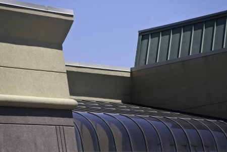 coming together: Parts of several buildings showing the coming together of a variety of architectural shapes.  Stock Photo