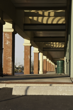 columns in a shopping mall along a walking path.  Stock Photo