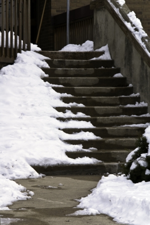 A set of steps with winter snow along the edges.  Stock Photo