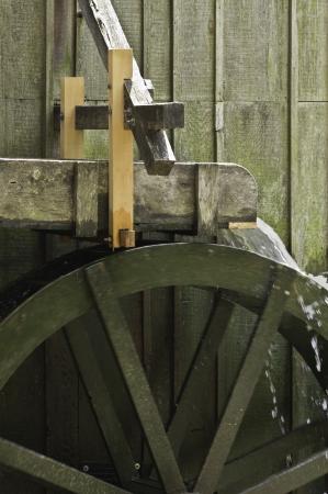 A miniutre water wheel as part of a state fair exhibit.