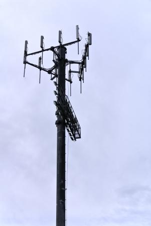 Utility pole against a heavily overcast sky.