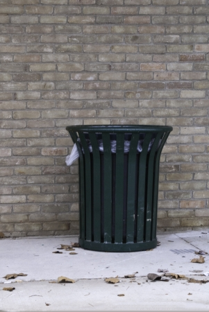 strategically: A strategically placed public trash container.  Stock Photo