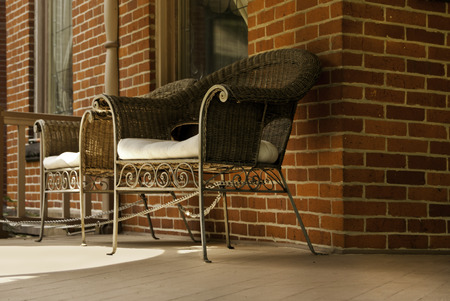 A modern front porch, modern in that the furniture had to be chained down.