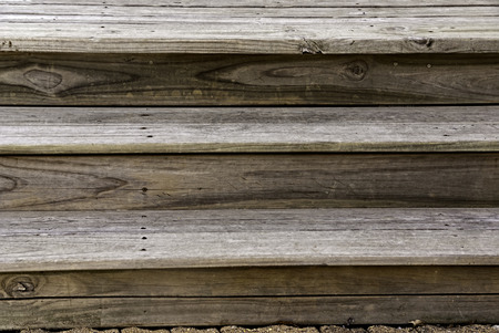 graining: Aging wooden steps showing with graining and faded aging. Stock Photo