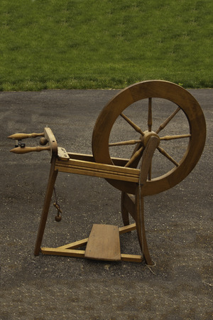 wheel spin: A spinning wheel in a yard sale. Stock Photo