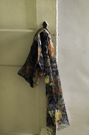 Silk Scarf on old rough wooden door and knob.