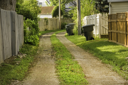 An alley access in a suburan area of a large city.