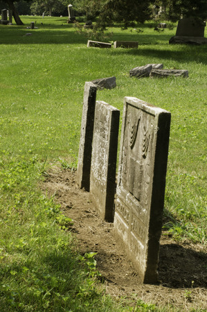 positioned: Head Stones positioned side by side as the familly is side by side. Stock Photo