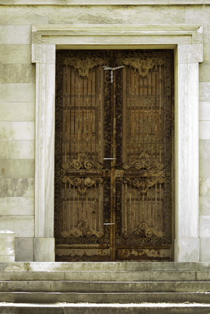 An ornate door on a chaple sturcture.
