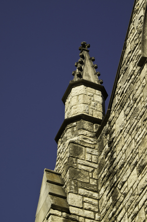 church steeple: A beautiful old stone church steeple against a gorgeous blue sky.