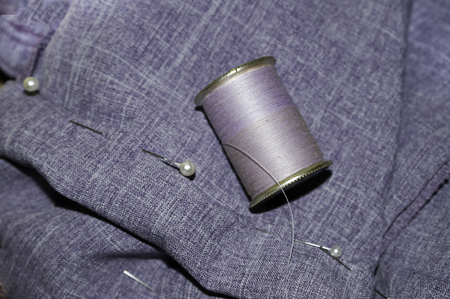 slacks: The second step in the process of hemming a pair of slacks.
