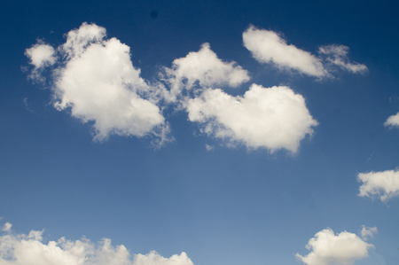 Brilliant blue sky with fluffy white clouds floating to eternity. Stock Photo