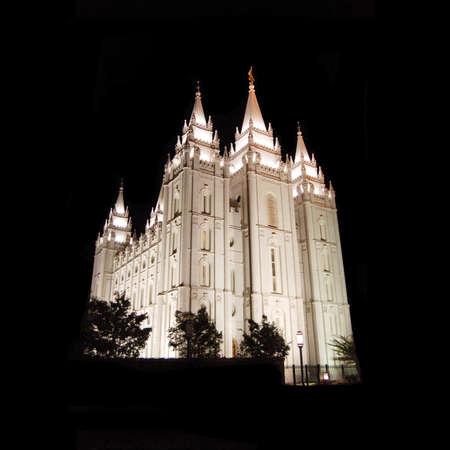 The Salt Lake Temple lit up at night Stock Photo