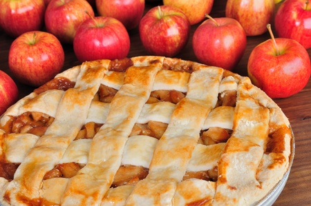 big apple: Big apple pie with apples in bacground