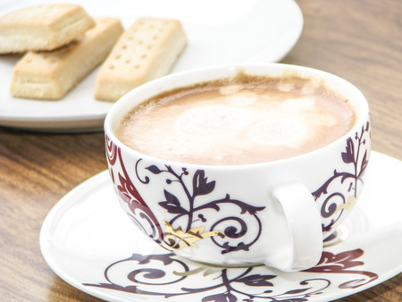 shortbread: Decorative coffee cup and shortbread biscuits