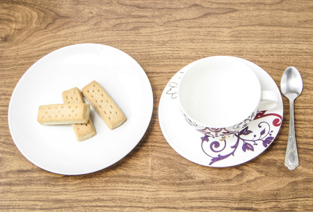 habbit: Decorative empty coffee cup and shortbread biscuits Stock Photo