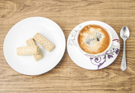 habbit: Coffee cup and shortbread biscuits. View from above