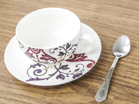 habbit: Decorative empty coffee cup and spoon on the table Stock Photo