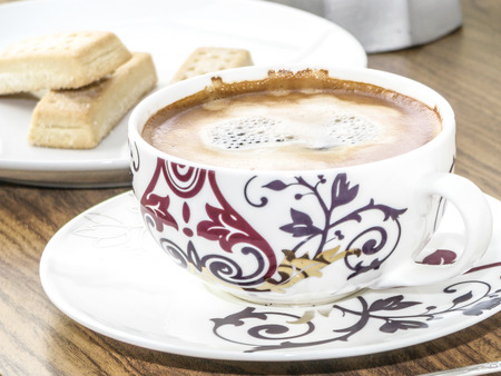 habbit: Decorative coffee cup and shortbread biscuits, and coffee maker