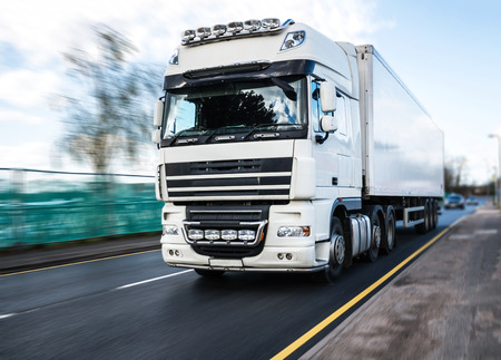 white heavy goods vehicle in motion