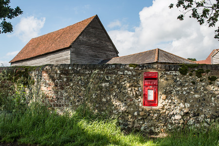 Vintage red letter box in a stone wall