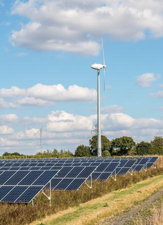 solar farm: Renewable energy. Solar farm and wind turbine. Stock Photo