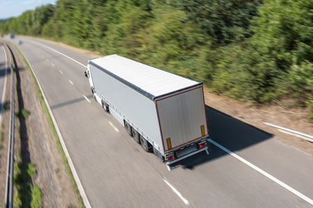 despatch: Grey lorry in motion on the motorway