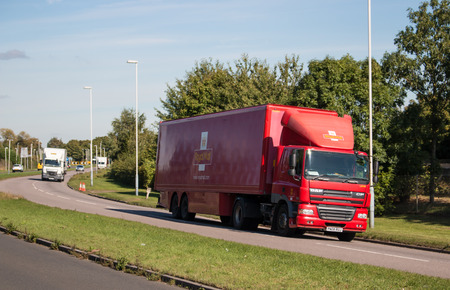royal mail: LONDON, UK - October 2016: Red Royal Mail lorry on the road in London Editorial