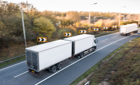 Lorry on the road blurred in motion Stock Photo