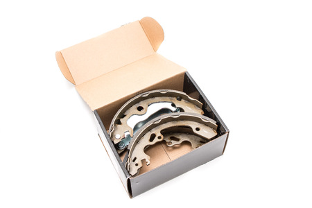 New cars break shoes kit in the box on the white background