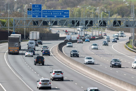 truck driver: London, UK - March 05, 2017: Traffic on the busiest British motorway M25 Editorial