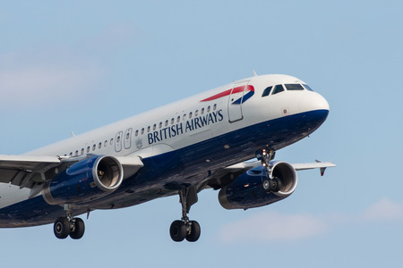 LONDON, UK - JULY 9, 2017: Plane Airbus A320 British Airways landing at London Heathrow Airport