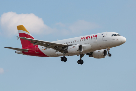 London, UK - July 9, 2017: Plane Airbus A319 Iberia Airlines landing at London Heathrow Airport