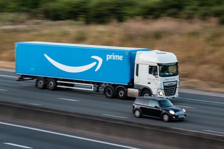 Watford, UK - July 22, 2018: Lorry belonging to Amazon, in motion on the British motorway M1 Редакционное