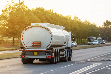 White tanker lorry on the road during sunset