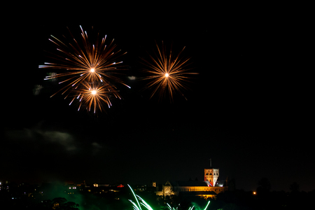 St. Alban, UK - November 03, 2018: Fireworks display in Verulamium Park as a part of celebration of Bonfire night. In the background St. Albans Cathedral. Editorial