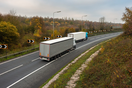 Road transport. Articulated lorry in motion on the road Фото со стока