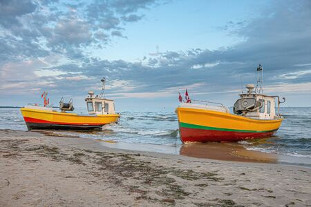 Two small fishing boats on the beach