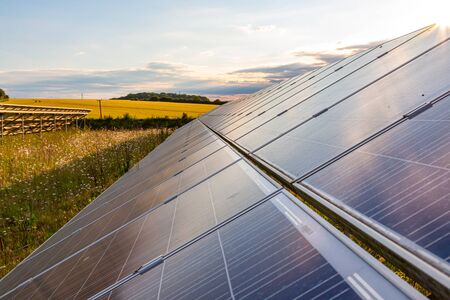 Solar panels at sunset, photovoltaic, alternative source of energy.