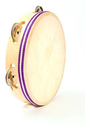 tambourine: Tambourine on white. Stock Photo