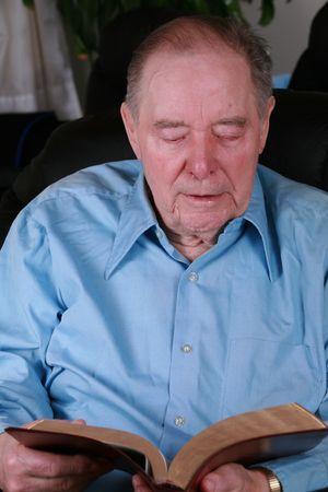 recliner: Elderly man reading Bible in recliner