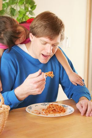 Child patiently waiting for dad to finish eating his dinner Stock Photo - 1772032