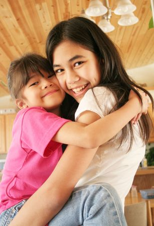 Two sisters hugging Stock Photo