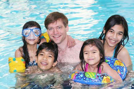 swimming race: Family enjoying time together in the pool