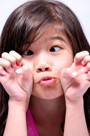 puckered: Little girl making a funny face and hand gestures