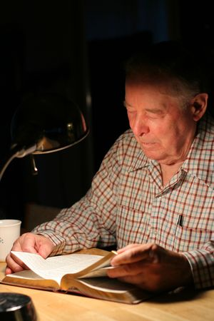 lamp: Elderly man reading his Bible by the lamplight